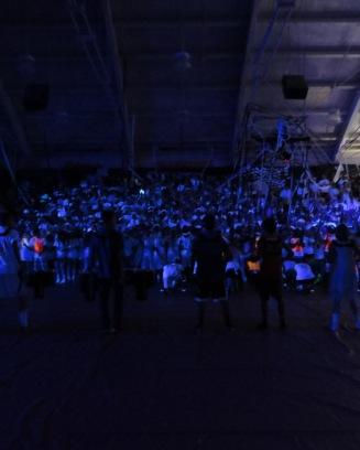 The senior class under the black lights.