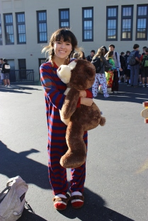 Junior Elissa Wickham matches her striped sock monkey onesie with her stuffed monkey.
