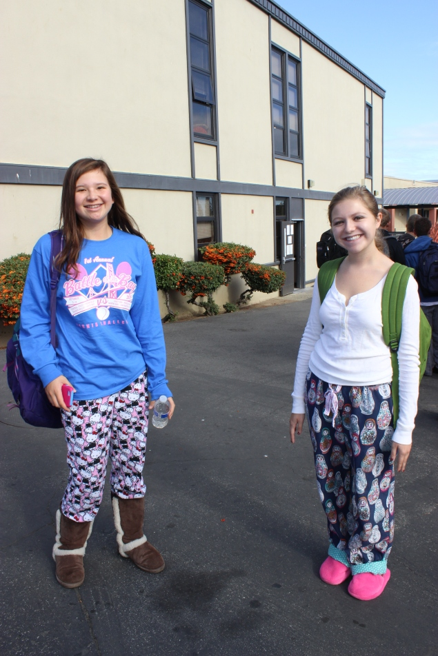 Sophomore Annie Hall and junior Chloe Weiner don printed pants and fuzzy shoes.
