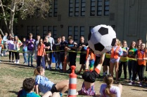 One student does a backflip to get the ball.