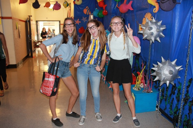 Students dressed as mathletes explore the main hall