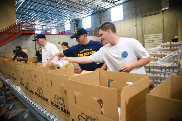 090916-N-3271W-063 MCCARRAN, Nev. (Sept. 16, 2009) Sailors from the Ohio-class fleet ballistic-missile submarine USS Nevada (SSBN-733) and Navy Recruiting Command Portland fill food boxes at the Food Bank of Northern Nevada for area needy families during Reno Navy Week. Navy Weeks are designed to show Americans the investment they have made in their Navy and increase awareness in cities that do not have a significant Navy presence. (U.S. Navy photo by Senior Chief Mass Communication Specialist Gary Ward/Released)