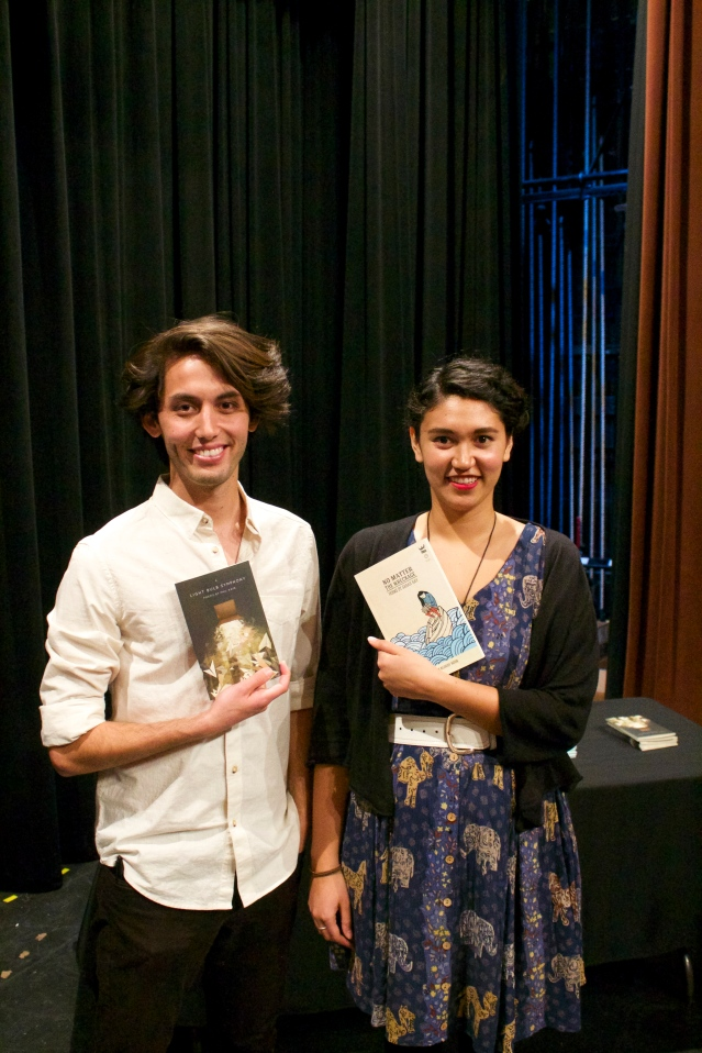 Sarah and Phil with collections of their poetry