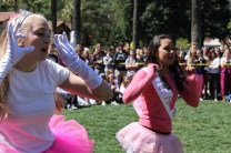 Seniors Camille Hench and Emma Weidling dance in their Toddler in Tiaras costumes.