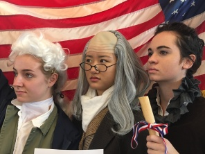 Seniors pose in their Founding Fathers costumes.