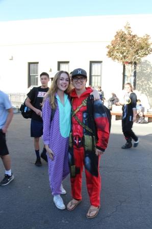 Seniors Scotty Bohn and Makenna Moore pose in their onesies.