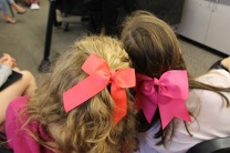Cheer and dance team members sport their pink bows.