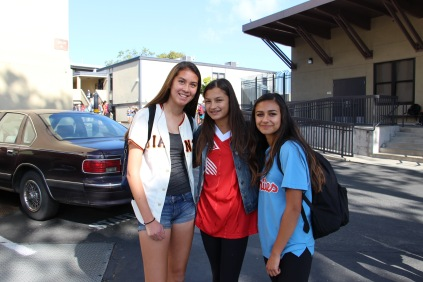 Freshmen girls flash their smiles and sports jerseys.