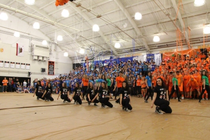 The dance team smiles during their performance.