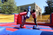 A head on inflatable jousting battle shot during a game.