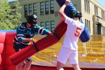 A student jabs at another in their joust battle.