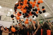 Balloons drop signaling the end of the rally.