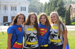 Sophomore girls pose in their hero costumes.