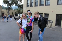 Freshman photo bombs sophomores repping their 60s attire