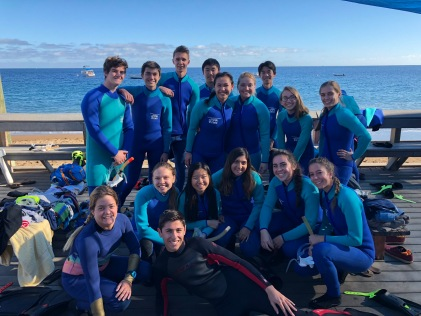WET SUITED UP: Students are all smiles as they prepare to snorkel in the Toyon Bay.