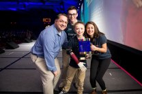 BBYO VP's of Judaism present Zachary Pamboukas with an award.