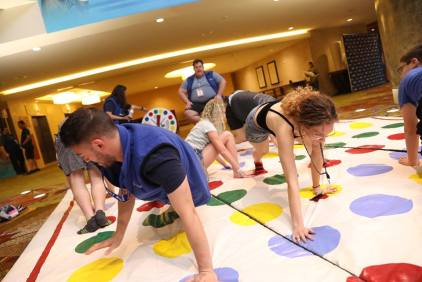 Teens and staff play twister.