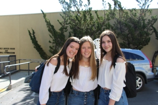 Freshman girls dressed in a trio.