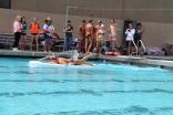 Junior boy Cooper Powell swims across the pool.