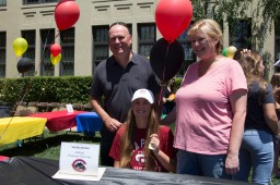Annika Briski, pictured with her parents, will be attending Chapman University to play softball.