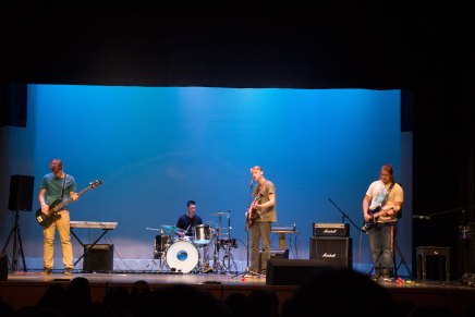 """William Fulton, Billy Evens, Colton Landaiche, and Benjamin Wong perform the song """"Walk."""""""