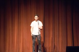 """Xavier Downs recite his poem """"Sequel to the audience."""