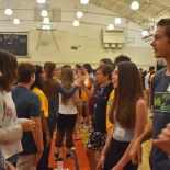 Freshman introduce themselves to each other in their lines as another activity